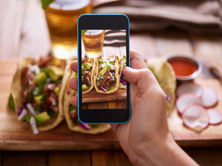 Sticker - taking photo of street tacos with smartphone