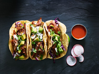 three mexican pork carnitas tacos flat lay composition Wall mural