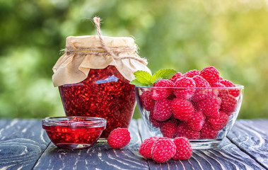 Fototapete - Raspberry jam  and fresh raspberry on a rustic wooden table