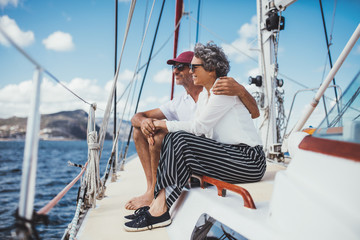 Mature couple relaxing on sailboat