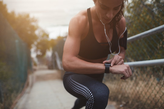 Woman setting up the smartwatch for the stairs climbing