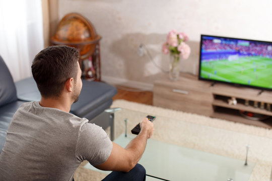 Man watching soccer in living room
