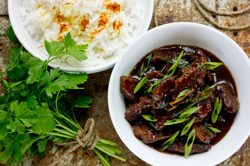 Mongolian meat - beef stewed in sauce with spices in asian style