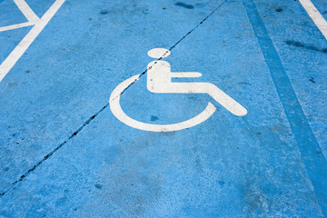 handicapped parking sign on the cement floor