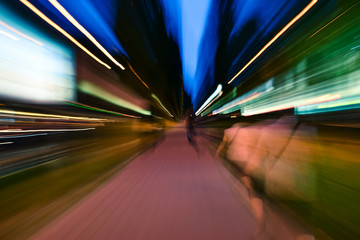 Night city accelerating blurred motion walking people. Speed concept