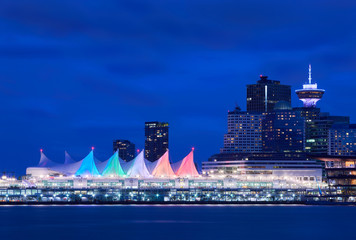 Canada Place Night Sails. Downtown Vancouver and the convention center at twilight. Vancouver, British Columbia, Canada.
