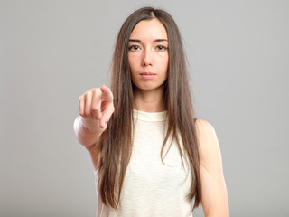 Woman pointing finger to viewer