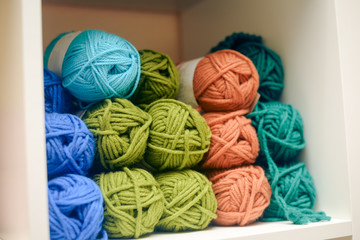 Knitting yarn on shelf, photo closeup