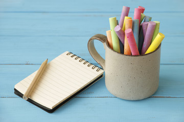 Stock Photo:.Open Notebook and school or office tools on wood ta
