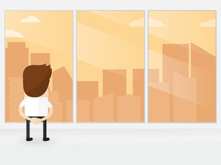 businessman or manager looking out of big window watching skyline with a great city view