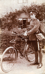 English soldier with bike, gun and uniform. Young man 1920th, vintage photo