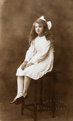 Beautiful english girl in white dress, vintage portrait 1910th