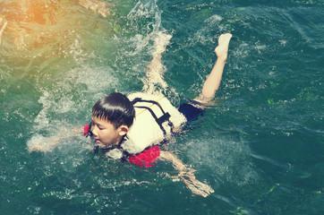 asian boy enjoy snorkle in phuket, thailand