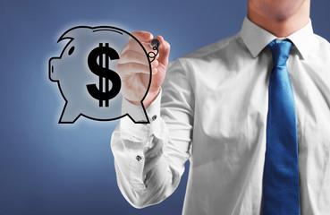 Businessman drawing piggy bank on virtual screen