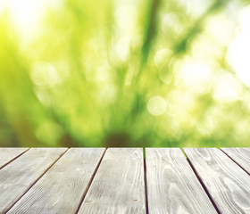 Abstract nature bokeh background and empty wood table