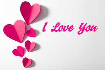 Pink paper heart isolated on white background with copy space
