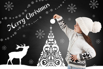 Little girl in a trendy knitted clothes and drawn Christmas tree on blackboard background
