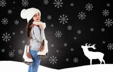 Little girl with skates in trendy knitted clothes and drawn snowflakes on blackboard background