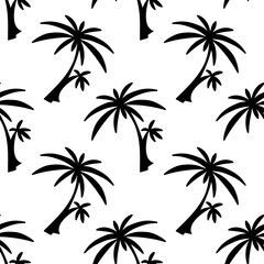 Seamless pattern with silhouettes palm trees