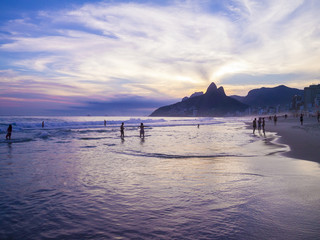 Dusk sunset scenic view of Ipanema Beach with Two Brothers Dois Irmaos Mountain of the Rio de Janeiro, Brazil city skyline