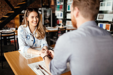 Couple dating in restaurant