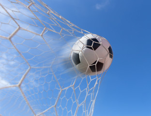 Fototapeta soccer ball in goal with blue sky