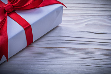 Giftbox with red bow horizontal image holidays concept
