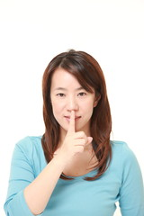 middle aged Japanese woman whith silence gestures