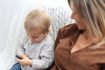mother and son using electronics