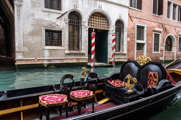 Empty gondola in a Venice's canal