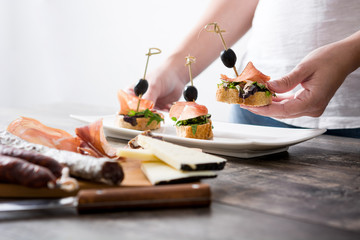 Woman Hands Preparing Sandwiches