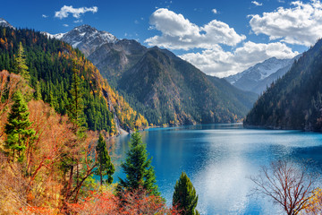 Beautiful view of the Long Lake among colorful fall woods