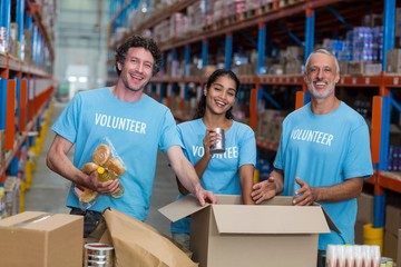Happy volunteer are posing and smiling during work