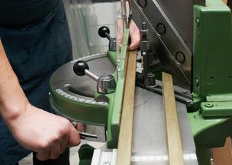 Craftsman working on frame in frameshop.