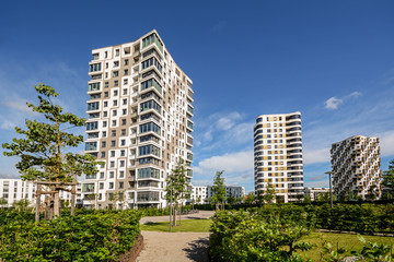 Multistory flats in the city - Facade of new modern residential houses Fototapete