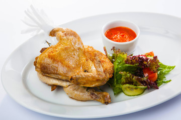 Chicken with sauce and salad
