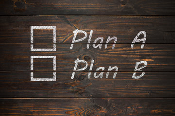Plan A or Plan B, written on a wooden old board. The concept of