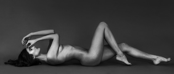 Sensual naked woman portrait with gorgeous body lying letterbox