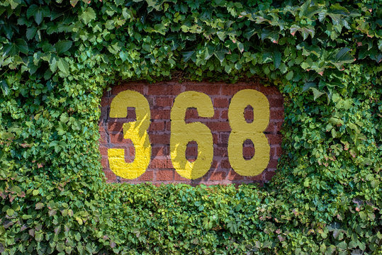 368 feet sign on the outfield wall of Wrigley Field in Chicago, Illinois