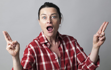 surprised woman showing fingers like fun guns for female power