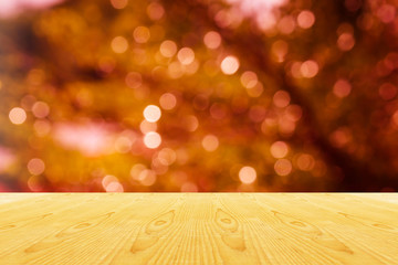 Blank area or space table top on bokeh light shining and Xmas or event orange and gold sparkle