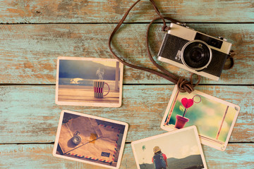 Photo album of remembrance, love and nostalgia in summer journey trip on wood table. instant photo of camera - vintage and retro style