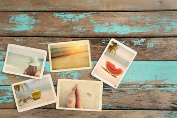 Photo album of journey honeymoon trip in summer on wood table. instant photo of vintage camera - vintage and retro style