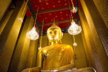 Golden Buddha statue in Thai Buddhist temple at Wat Kalayanamitr, Bangkok Thailand