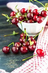 Fresh cherry on rustic background