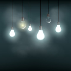 Light bulbs hanging on wires. Stock vector.