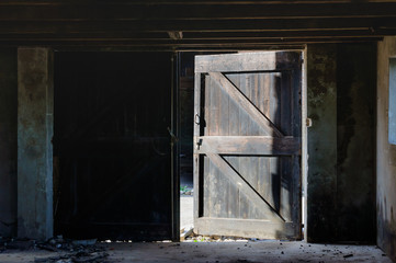 Open door of a dilapidated barn