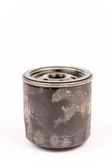 Old used car oil filter isolated over white background