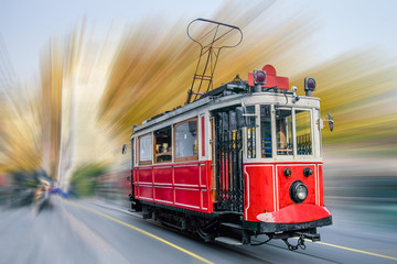 Old red tram at the street.