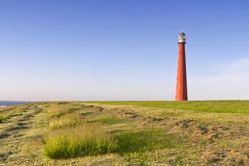 Lighthouse Lange Jaap unde a blue sky in Den Helder, The Netherlands.